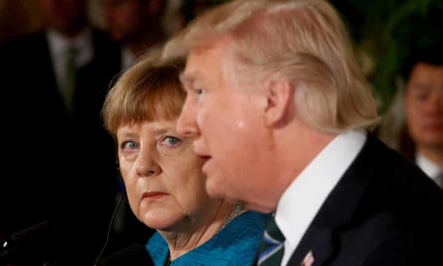 Angela Merkel watches Donald Trump during a joint news conference at the White House in March 2017.