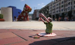 Melted tourist near the Guggenheim in Bilbao, Spain, by Isaac Cordal.