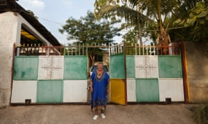 Mireille Ain, a French manbo (Vodou priestess), in front of her peristyle in Jacmel, on the southern coast of Haiti.