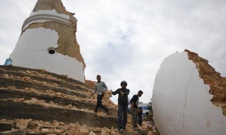 Volunteers remove debris at the historic Dharahara tower