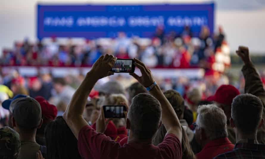 A supporter takes a picture at Trump's campaign rally.
