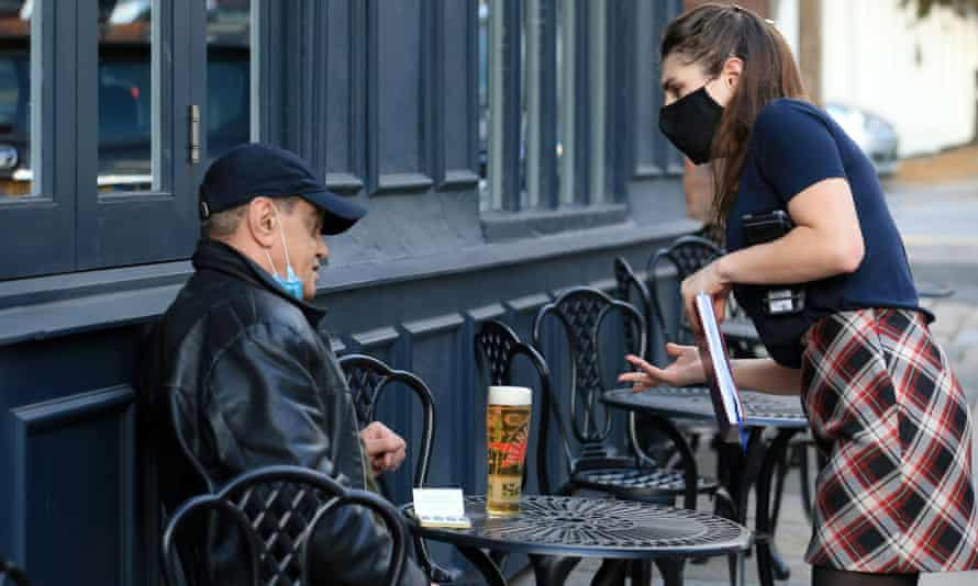 A customer in Liverpool enjoys a beer outside.