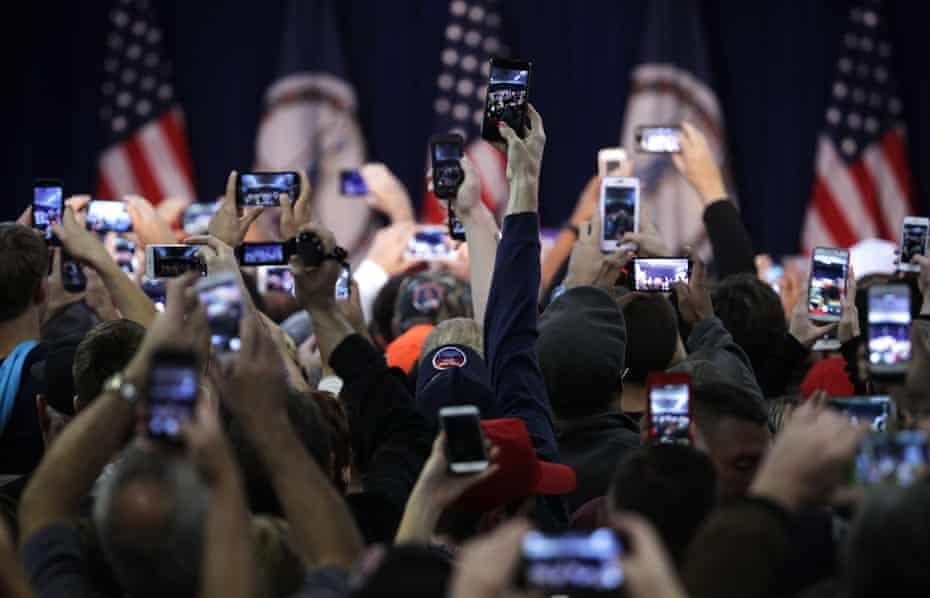 Supports hold up camera phones at a Trump rally in Virginia.