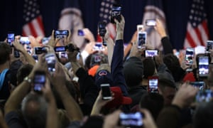A sea of smartphones at a Trump rally in Virginia. The president-elect has said he would, among other things, get Apple to start making iPhones in the US.