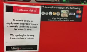 A customer notice on a car park ticket machine in Liverpool after the new 12-sided £1 coin entered circulation today.
