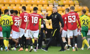 Ole Gunnar Solskjær congratulates his players after their win at Norwich on Saturday