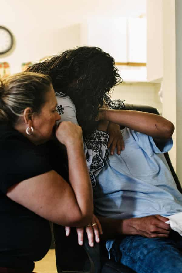 Marta and her daughter Carmen comfort José at Marta's home.
