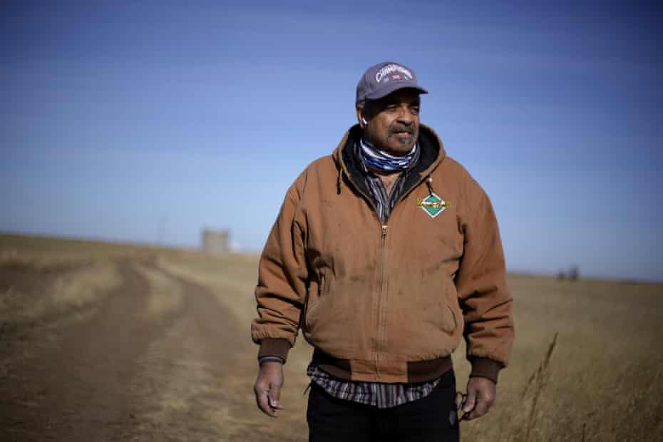 Rod Bradshaw stands in a field of wheat on his farm near Jetmore, Kansas on 13 January 2021. Joe Biden's nomination of Tom Vilsack to lead the agriculture department is getting a chilly reaction from many Black farmers who contend he didn't do enough to help them the last time he had the job.