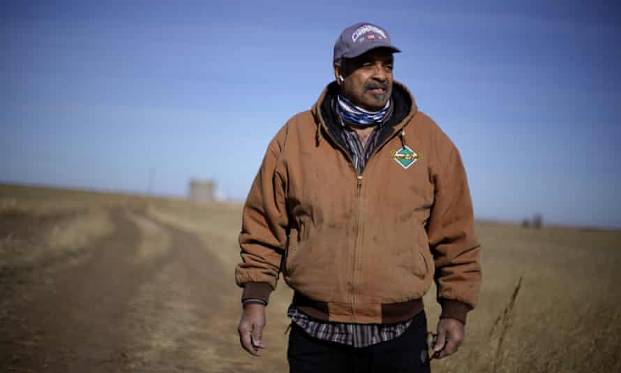 Rodney Bradshaw stands in a field of wheat on his farm near Jetmore, Kansas