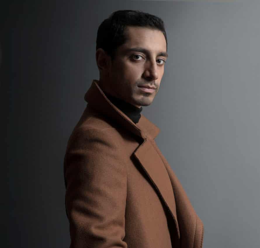 Wrapped up: Riz Ahmed wearing wool coat by Lanvin.