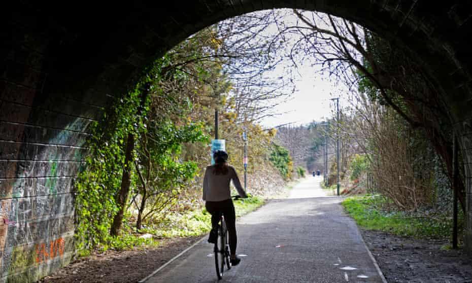 Cyclist on the Innocent Railway path towards Portobello from central Edinburgh.