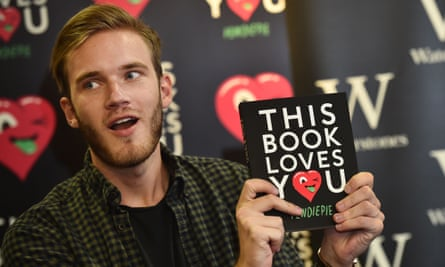 Swedish video game commentator Felix Kjellberg, aka PewDiePie poses with his new book, This Book Loves You.