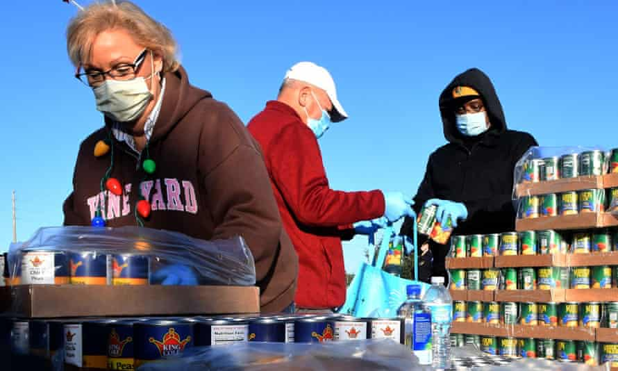 Volunteers prepare food assistance for the needy. Central Florida food banks struggle to serve those facing food insecurity amid the COVID-19 pandemic.