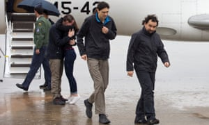 Ángel Sastre, right, with fellow journalists José Manuel López, centre, and Antonio Pampliega, arrive at Torrejón's military airport in Spain after being released from captivity in Syria.