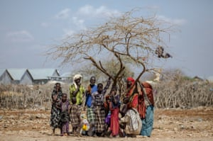 Somalians displaced by fighting wait to take shelter under a tree at Balanbaalis camp in as the central and southern parts of Somalia were gripped by extreme drought in March 2017.
