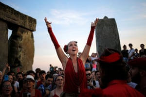 A singer leads fellow revellers in song