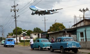 Air Force One, carrying the president and his family, flies over Havana