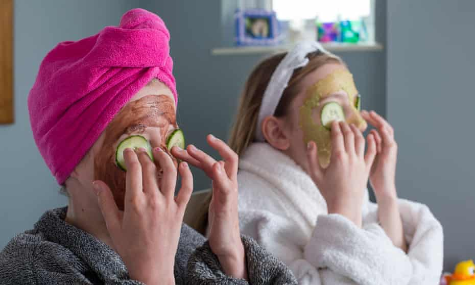 young girls with facemasks and cucumber on eyes
