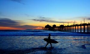 A surfer in silhouette at Huntington Beach, California.