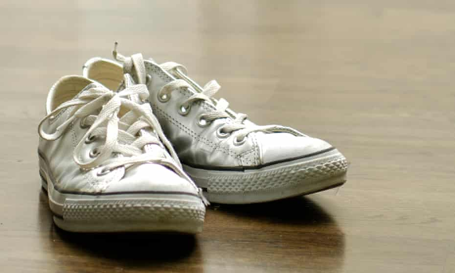 Canvas shoes on hardwood floo