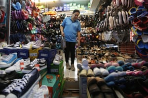 A customer goes shopping for shoes in Bangkok