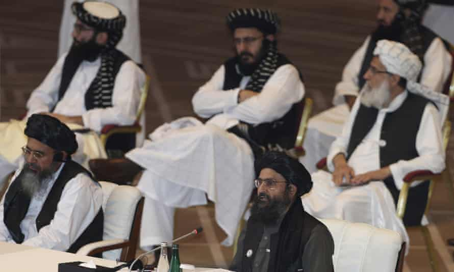 Taliban co-founder Mullah Abdul Ghani Baradar, bottom right, speaking last September at the opening session of peace talks between the Afghan government and the Taliban in Doha, Qatar.