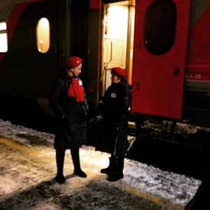 Two provodnitsa (carriage attendants) confer.