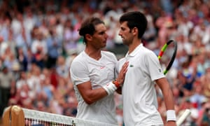 Rafael Nadal congratulates Novak Djokovic after the No 12 seed won their semi-final in five sets.