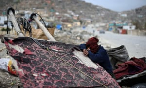 An Afghan garbage collector take rest at a rubbish dumping site