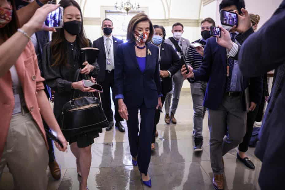 Nancy Pelosi arrives at the US Capitol on Friday as talks continue.