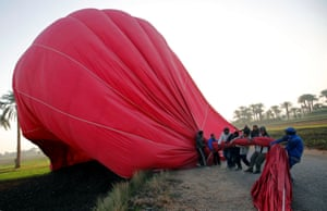 Luxor, Egypt Crew members work to secure a hot-air balloon