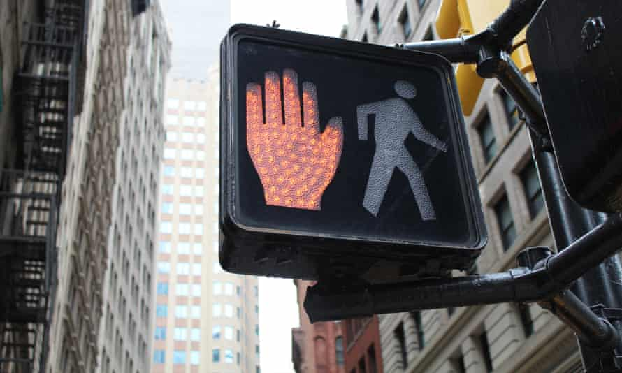 Pedestrian crossing sign in New York City