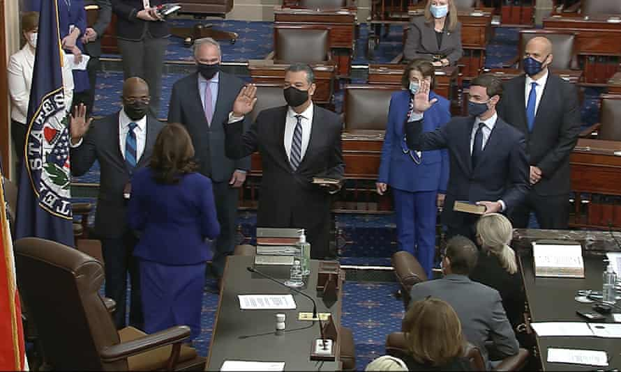 Kamala Harris swears in Raphael Warnock, Alex Padilla and Jon Ossoff on the floor of the Senate.