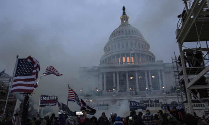 Security forces respond with teargas after a mob of Trump supporters breached the US Capitol on Wednesday.