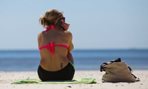BP Case Shifts to Pollution Fines That May Top $17 Billion<br>A woman talks on the phone while sitting on a beach that was affected by the PB Plc oil spill in Gulfport, Mississippi, U.S., on Monday, March 5, 2012. BP Plc may face as much as $17.6 billion in civil pollution fines and possibly billions of dollars more in criminal penalties as its settlement with businesses and individuals harmed by the 2010 Gulf of Mexico oil spill shifts the focus to government claims. Photographer: Julie Dermansky/Bloomberg via Getty Images AMERICA;