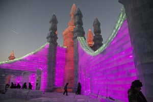 Labourers work to finish large ice sculptures in preparation for the festival