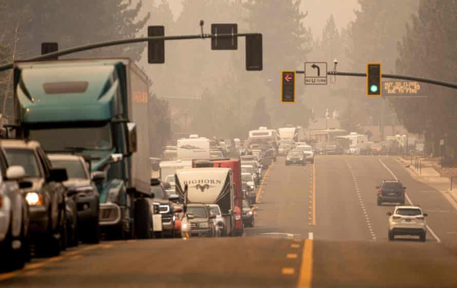 Residents are stuck in gridlock while attempting to evacuate as the Caldor fire approaches in South Lake Tahoe on Monday.