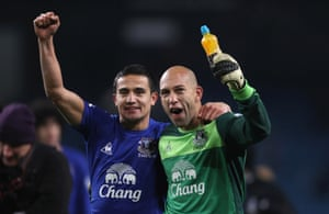 Tim Cahill and Tim Howard celebrate after beating Manchester City in 2010.