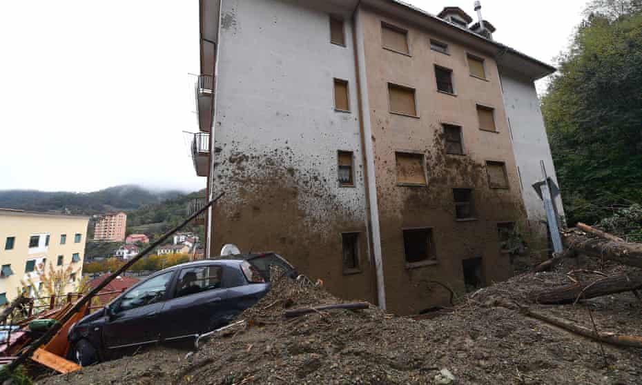 A car hit by the landslide that damaged a building in Rossiglione, Genoa.