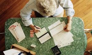 An elderly woman doing her accounts