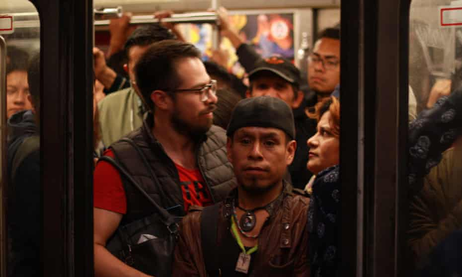 Passengers struggle to fit onto an overcrowded train at the Balderas metro station in Mexico City.