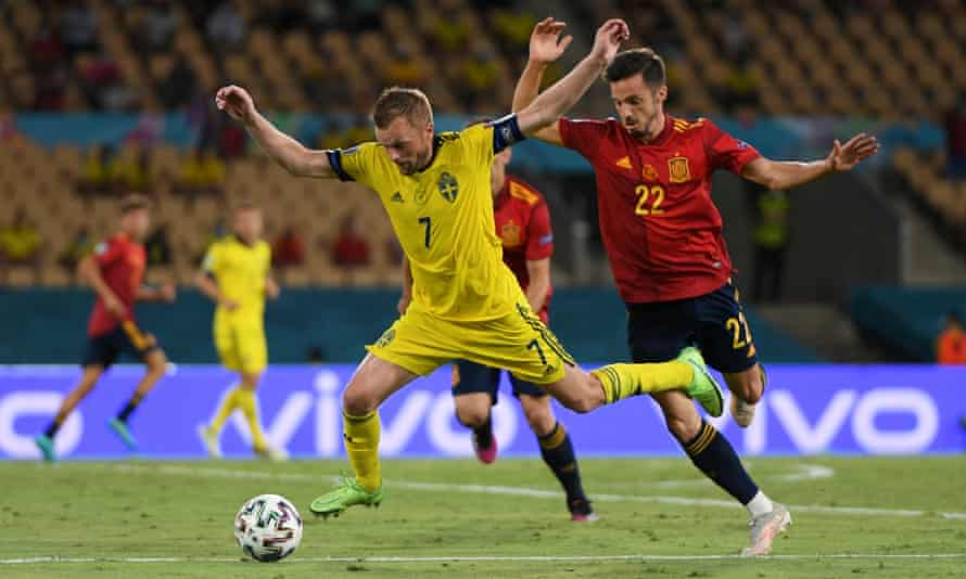Sebastian Larsson falls over after a challenge by Spain's Pablo Sarabia.