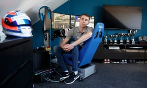 Graham Carroll, a sim-driver who competes in races from the rig set up in his bedroom