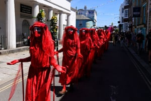 The Red Brigade take part in an Extinction Rebellion protest in Falmouth during the G7 Summit.
