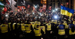 Protesters clash with police during the Million Mask demonstration in central London.