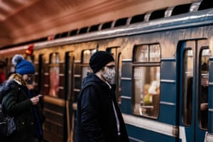 A man wearing a protective face mask waits for a metro train in Moscow on Monday