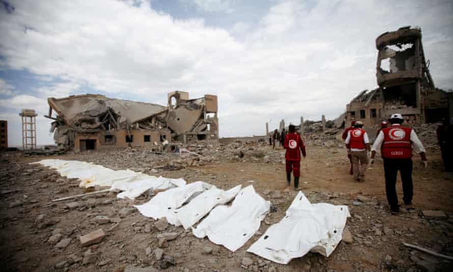 Red Crescent medics attend the scene of the air strike