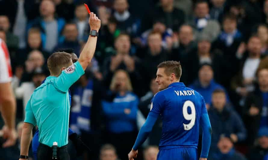 Jamie Vardy is shown a red card by the referee Craig Pawson following his tackle on Mame Biram Diouf.