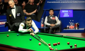 Mark Selby tries his luck with the rest during his semi-final against Ding Junhui at the Crucible Theatre.
