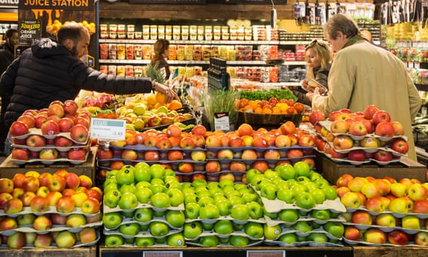 Customers browsing the fruit and vegetables section of the Whole Foods Market.